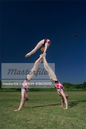 Acrobatic troop performing moves Stock Photo - Premium Royalty-Free, Image code: 649-03622537