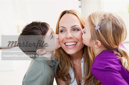 brother and sister kissing her mother Stock Photo - Premium Royalty-Free, Image code: 649-03666117