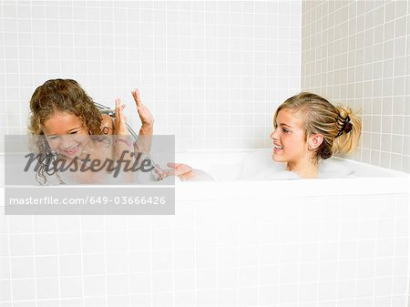 Sisters playing in a bath, foam Stock Photo - Premium Royalty-Free, Image code: 649-03666426
