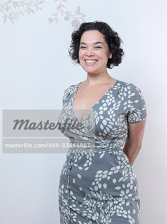 Curvy Woman standing up and smiling. Stock Photo - Premium Royalty-Free, Image code: 649-03666807