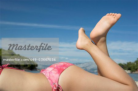 Girl laying on beach Stock Photo - Premium Royalty-Free, Image code: 649-03667036