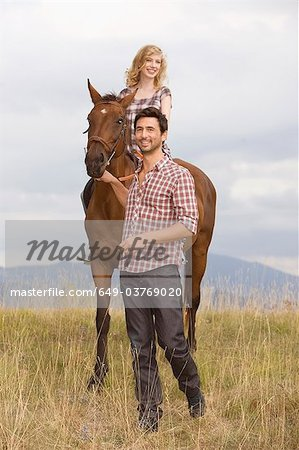 People and horses Stock Photo - Premium Royalty-Free, Image code: 649-03769020