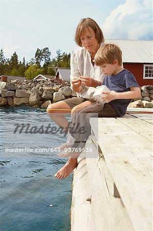 Grandmother and boy fishing from jetty Stock Photo - Premium Royalty-Free, Image code: 649-03769636