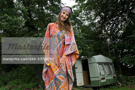 Hippy female by caravan Stock Photo - Premium Royalty-Free, Image code: 649-03769702