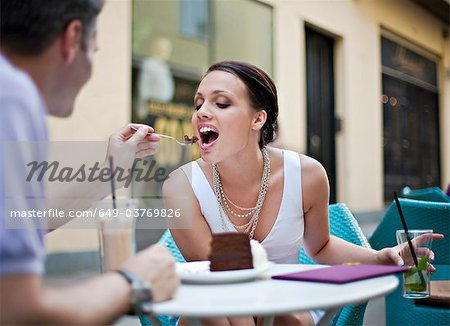 Young couple sitting in outdoor café Stock Photo - Premium Royalty-Free, Image code: 649-03769826