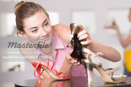Young woman in shoe shop Stock Photo - Premium Royalty-Free, Image code: 649-03771013