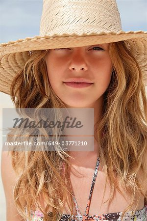 Pretty women in straw hat in the sun Stock Photo - Premium Royalty-Free, Image code: 649-03771210