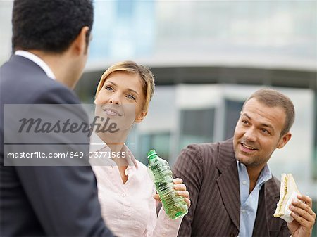 Businesspeople eating outdoors Stock Photo - Premium Royalty-Free, Image code: 649-03771585