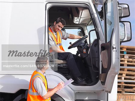 Truck driver and dispatch worker talk Stock Photo - Premium Royalty-Free, Image code: 649-03773428