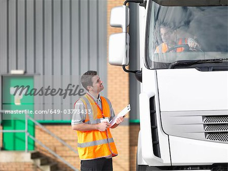 Inspector and truck driver talking Stock Photo - Premium Royalty-Free, Image code: 649-03773433