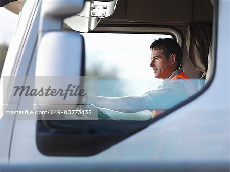 Truck driver in truck cab Stock Photo - Premium Royalty-Free, Image code: 649-03773435