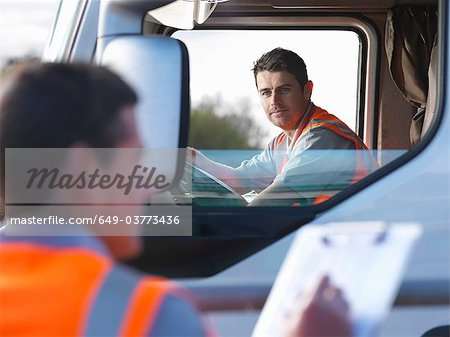 Truck driver with worker taking notes Stock Photo - Premium Royalty-Free, Image code: 649-03773436