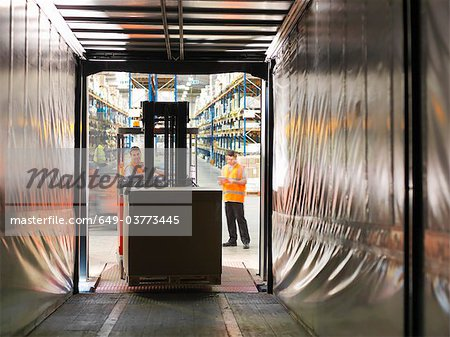 Workers loading truck with forklift Stock Photo - Premium Royalty-Free, Image code: 649-03773445