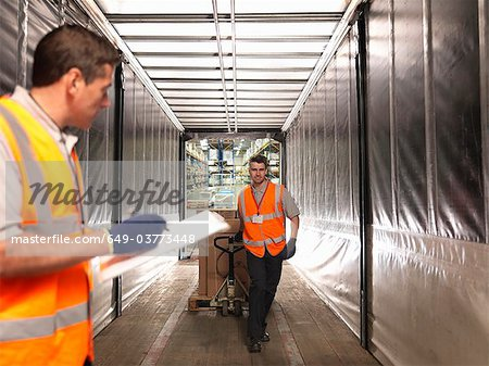 Workers loading truck Stock Photo - Premium Royalty-Free, Image code: 649-03773448