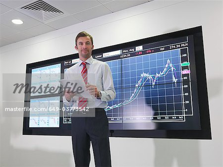 Businessman with graph on screen Stock Photo - Premium Royalty-Free, Image code: 649-03773542