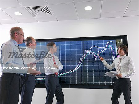 Business meeting with graphs on screen Stock Photo - Premium Royalty-Free, Image code: 649-03773544