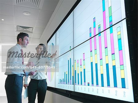 Businessmen with graphs on screen Stock Photo - Premium Royalty-Free, Image code: 649-03773549