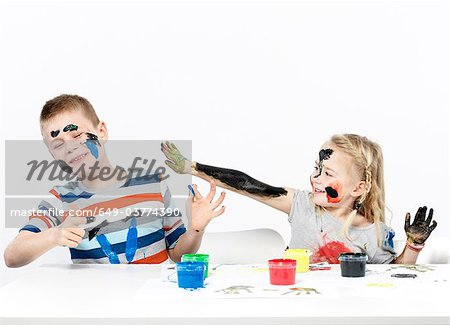 Kids playing with finger paint Stock Photo - Premium Royalty-Free, Image code: 649-03774390