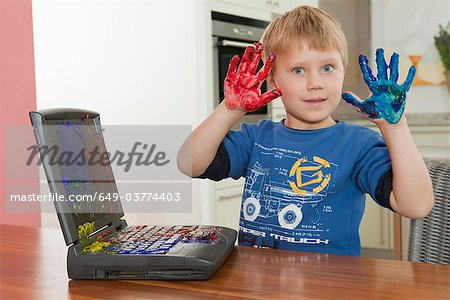 Boy showing dirty hands Stock Photo - Premium Royalty-Free, Image code: 649-03774403