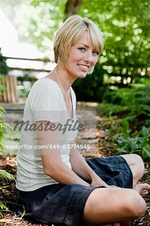 Young woman relaxing in garden Stock Photo - Premium Royalty-Free, Image code: 649-03774945