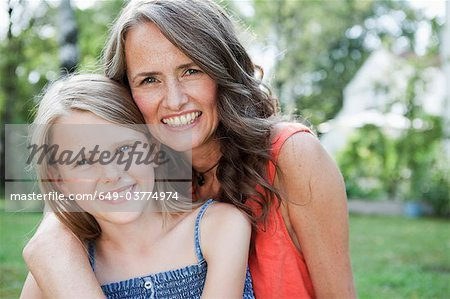 Mother and daugther in garden Stock Photo - Premium Royalty-Free, Image code: 649-03774974