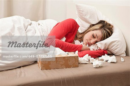 Woman with cold sleeping Stock Photo - Premium Royalty-Free, Image code: 649-03797105