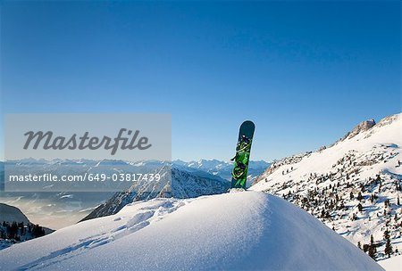 Snowboard in winter landscape Stock Photo - Premium Royalty-Free, Image code: 649-03817439