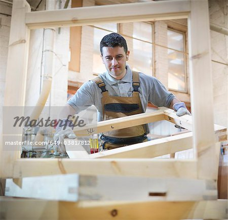 Woodworker with window frames Stock Photo - Premium Royalty-Free, Image code: 649-03817812