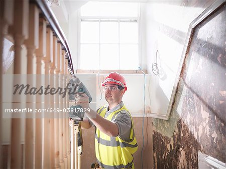 Builder renovating staircase Stock Photo - Premium Royalty-Free, Image code: 649-03817829