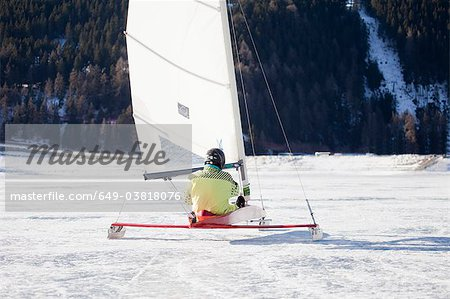 Ice salior sledding across frozen lake Stock Photo - Premium Royalty-Free, Image code: 649-03818076