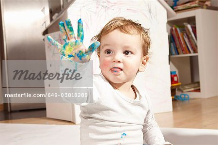 Boys hand covered with finger paint Stock Photo - Premium Royalty-Free, Image code: 649-03818288