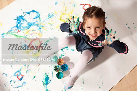 Little girl playing with finger paint Stock Photo - Premium Royalty-Free, Image code: 649-03818290