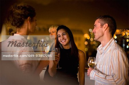 People having wine on terrace at night Stock Photo - Premium Royalty-Free, Image code: 649-03857285