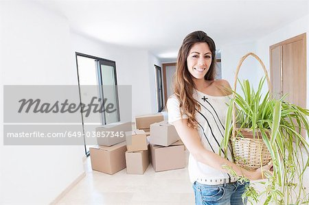 Woman moving into new home Stock Photo - Premium Royalty-Free, Image code: 649-03857345