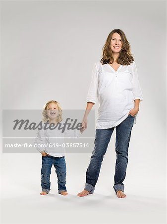 Pregnant woman holding daughter's hand Stock Photo - Premium Royalty-Free, Image code: 649-03857514