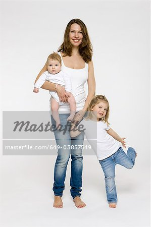 Mother and children standing together Stock Photo - Premium Royalty-Free, Image code: 649-03857549