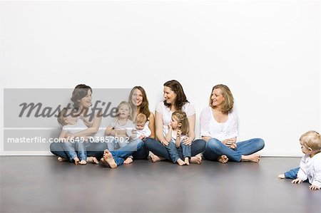 Mothers and children sitting together Stock Photo - Premium Royalty-Free, Image code: 649-03857902