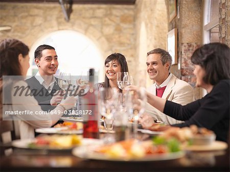 People celebrating in restaurant Stock Photo - Premium Royalty-Free, Image code: 649-03858172