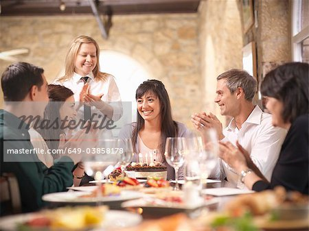 People celebrating in restaurant Stock Photo - Premium Royalty-Free, Image code: 649-03858178