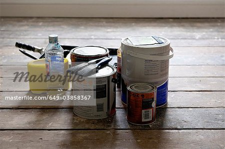 Paint cans and brushes in empty house Stock Photo - Premium Royalty-Free, Image code: 649-03858367