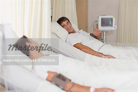 Patients talking in hospital beds Stock Photo - Premium Royalty-Free, Image code: 649-03881616