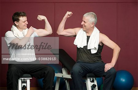 Father and son flexing muscles in gym Stock Photo - Premium Royalty-Free, Image code: 649-03882013