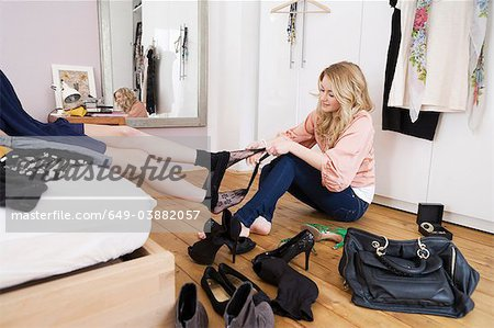 Teenage girl removing friend's tights Stock Photo - Premium Royalty-Free, Image code: 649-03882057