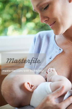Mother breast feeding her baby Stock Photo - Premium Royalty-Free, Image code: 649-03882182