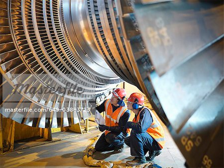 Workers inspect turbine in power station Stock Photo - Premium Royalty-Free, Image code: 649-03883723