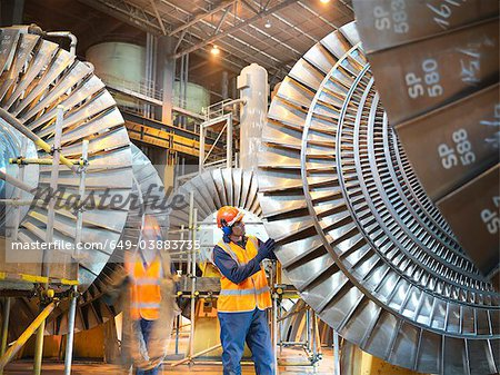 Workers with turbines in power station Stock Photo - Premium Royalty-Free, Image code: 649-03883735