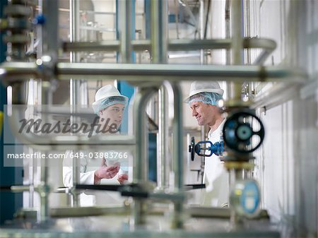 Workers inspecting goat yogurt in dairy Stock Photo - Premium Royalty-Free, Image code: 649-03883766