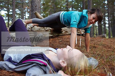 Women exercising together in forest Stock Photo - Premium Royalty-Free, Image code: 649-04248354