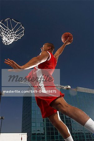 Basketball player about to dunk Stock Photo - Premium Royalty-Free, Image code: 649-04248875