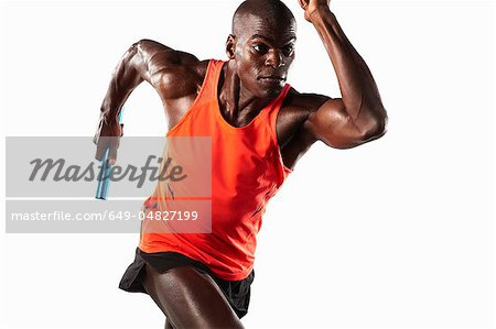 Athlete running with relay baton Stock Photo - Premium Royalty-Free, Image code: 649-04827199